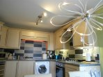 Kitchen,washing machine, dishwasher, fridge/freezer, table, chairs, gas hob/elec oven, mood lighting