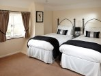 One of the twin bedrooms.  Beds fitted with vi-spring mattresses and hypoallergenic bedding.