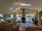 The living room is tastefully furnished and decorated, it looks out onto Lake Emily.
