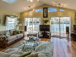 Comfortable Living room with large screen TV. Views of the deck and lake throughout the home.