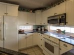 The updated kitchen has granite countertops, a smooth top range and refrigerator with ice dispenser in the door.