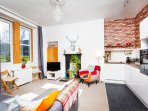 Living room & kitchen. Bright & spacious, spectacular views over Holyrood Park