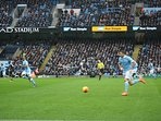 There are many Premier League Football teams in the north...Manchester City in action.