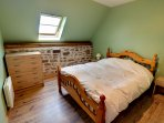 Lovely room with stone feature wall, fresh white linen.