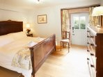 The Skiddaw Suite on the ground floor with a five foot bed and ensuite bath and shower room