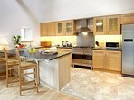 A massive breakfasting kitchen with Brittania range cooker, dishwasher and granite counter tops