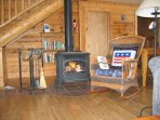 Wood burning stove in the Living room --rocking chair.  Delux comfort.