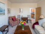 The colourful living area has plenty of comfortable seating.