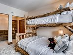 In addition to the rustic bunks, this room features a full-size pullout couch that sleeps one more.