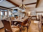 Between the elegant wood and leather chairs, grand dining table, and overhead chandelier, you can have a 5-star...