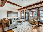 From the central Living Area, step onto the balcony for views of the slopes.