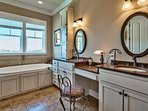 The master bath has two sinks, a jetted tub and impeccable design.