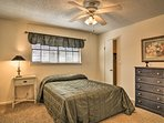 The second bedroom provides a comfortable queen bed.