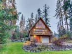 Rustic charm w/ modern amenities, an expansive back patio, lake view!