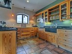 The kitchen offers a mix of granite and wooden countertops.