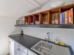 Loggia/top floor kitchen: Two induction hot plates, a combi oven and a fridge.