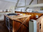 Mezzanine kitchen area, which is bespoke and handmade using reclaimed Cider Vats.