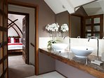Large, luxurious bathroom with his and hers sinks.