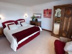 Superking-size bedroom (beds can be split into two singles) with spectacular views and large ensuite