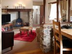 The lounge with Inglenook fireplace and wood burning stove.