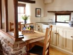 Kitchen/dining area with bespoke handmade cupboards.