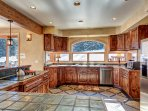 Kitchen with views of private deck