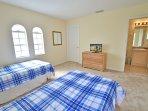 Bedroom 4 showing flatscreen TV and en-suite bathroom (shared)