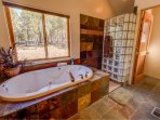 Master Suite features a Slate tile steam shower, double sinks and a soaker tub.