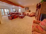 The lower level has a family room and a large game room and Dish Satellite TV.