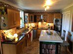 Full size fully equipped kitchen.