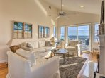Beach-themed decor adorns the light and airy living space.
