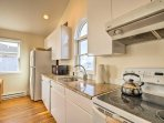 Granite countertops and modern appliances highlight the cooking space.