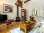 Lounge with cosy woodburner
