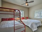 Kids will enjoy the second bedroom featuring a twin-over-full bunk bed and additional queen bed.