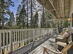 Unwind on the front deck featuring picturesque views of the surrounding pines.