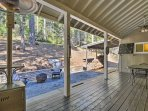 Have some fun outside on the back porch featuring a fire pit, ring toss game, dart board, and plenty of seating.