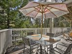 Dine al fresco at the outdoor table with seating for 4.