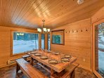 Dine around the sleek dining room table, encompassed by long-views windows.