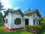 The main house of the hostel , a 120 years old house with beautiful Sri Lankan architecture