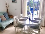 Newly furnished and stylish dining area with bed sofa. Archway to new modern granite kitchen.