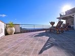 private terrace with table and stunning view