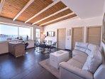 beautiful spacious living room with an amazing sea view of Taormina bay
