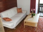 Double room - room with a bunk bed - a sofa with a tea table and a cable TV