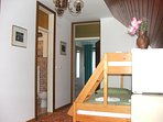 Double room - room with bunk bed, entrance to the room with double bed and entrance to the bathroom