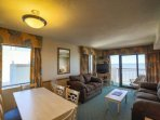 Spacious living space, Large flat screen TV, comfortable seating and amazing views from 3 directions.