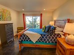 Relax and enjoy the  ocean peeks from the downstairs bedroom.