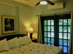 King size bed in master bedroom, shows fan and AC