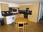 Fully equiped, Clean Kitchen/Dining Area  Freedom to eat what you want, when you want