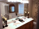 Master bath with jetted tub and walk in shower.