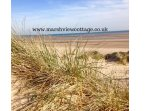 The dunes and vast sandy beach are a short walk from Marsh View Cottage, Camber Sands